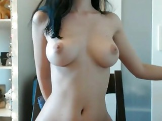 Solo chick plays with her big boobs