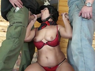 Horny mature slut fucking two guys at once