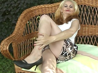 Hot blonde housewife playing with her wet pussy in the garden